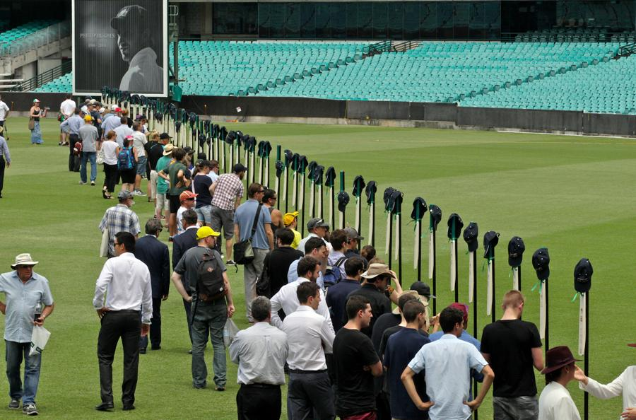 63 cricket bats @ the SCG.  Each marked with a milestone of Phillip Hughes career. PIC @thinkshootprod #63notout @smh http://t.co/tSmUJw2vgE