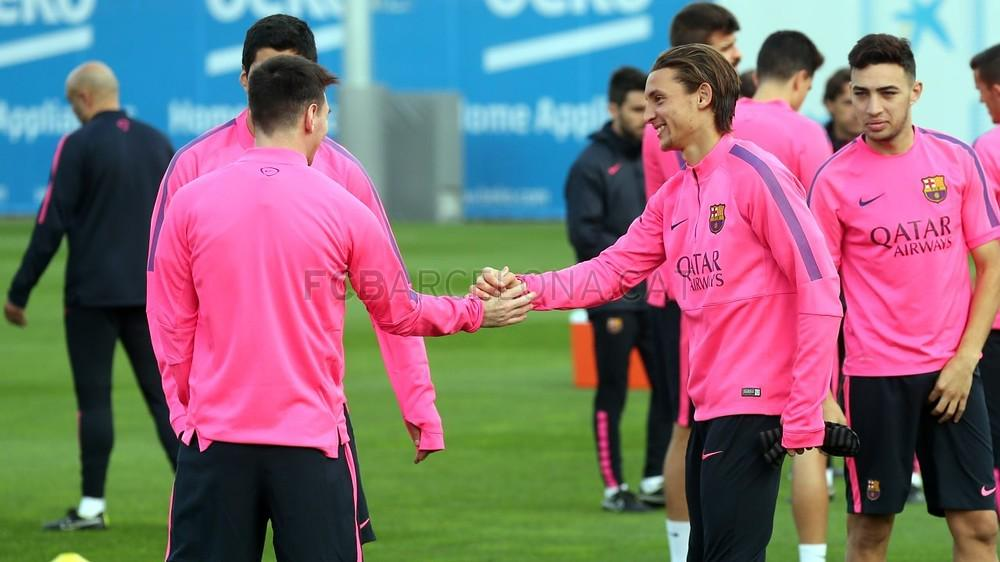 Babunski shakes hands with Messi during Sunday's training