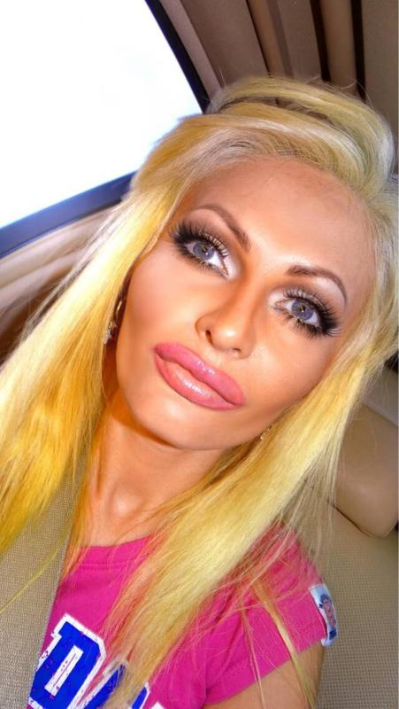 Victoria Wild has had £30k of surgery to make herself look like a sex doll http://t.co/4GNm7NKP2l http://t.co/7Ak1jQxx84