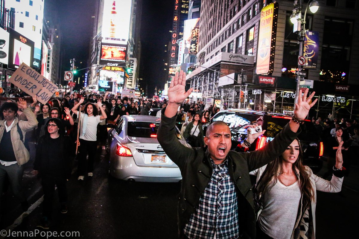 """Hands up, don't shoot!"" Hundreds of people taking to the streets of NYC tonight. #FergusonDecision http://t.co/SQ3xfg0ilq"