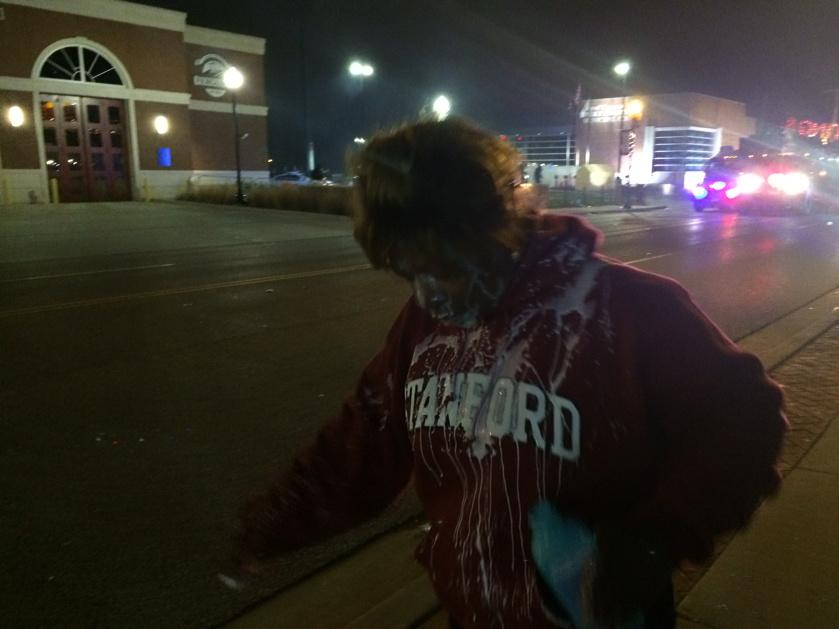 Choking on tear gas . Milk on face. I'm choking too police warned then fired the canister #Ferguson http://t.co/JAsqW7gV8e