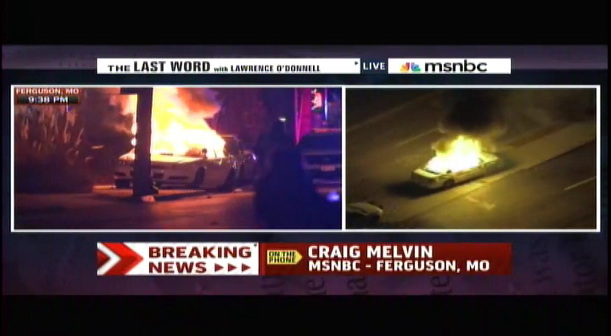 Police car on fire near Ferguson Police HQ http://t.co/4t2KKxI4G5