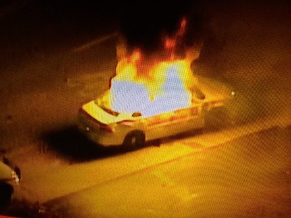 St Louis County Police car on fire in #ferguson http://t.co/yOxFM6fYr3