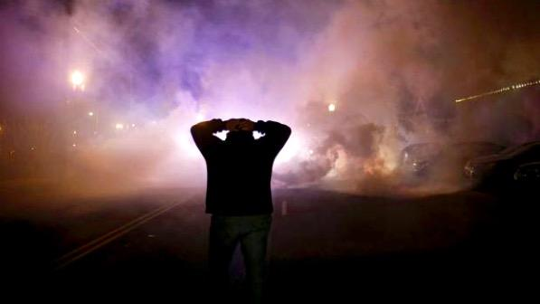 Powerful photo RT @WilliamsJon: Picture says so much: confusion, despair, anger in #Ferguson. (Photo: @Reuters) http://t.co/XilwlZhkmo
