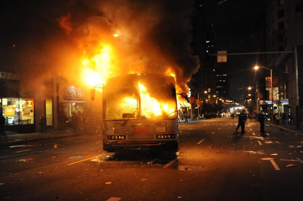 A bus burning in the street. Set on fire in San Francisco. In 2012. By Giants fans. http://t.co/pR2Ez7MTqp