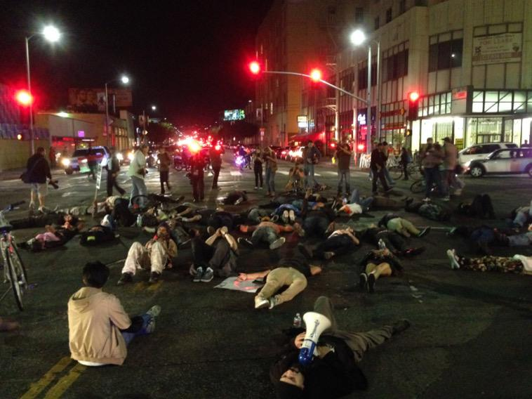 Protesters laying in the middle of LaBrea and Wilshire in silence #LosAngeles #ferguson http://t.co/IVDPFXbScY