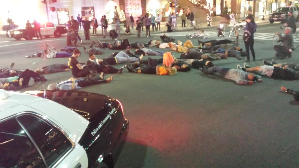 #Ferguson protesters lying in the middle of Beverly Hills' famous Rodeo Drive, playing dead for Michael Brown. @KTLA http://t.co/cFFm5gJz3D
