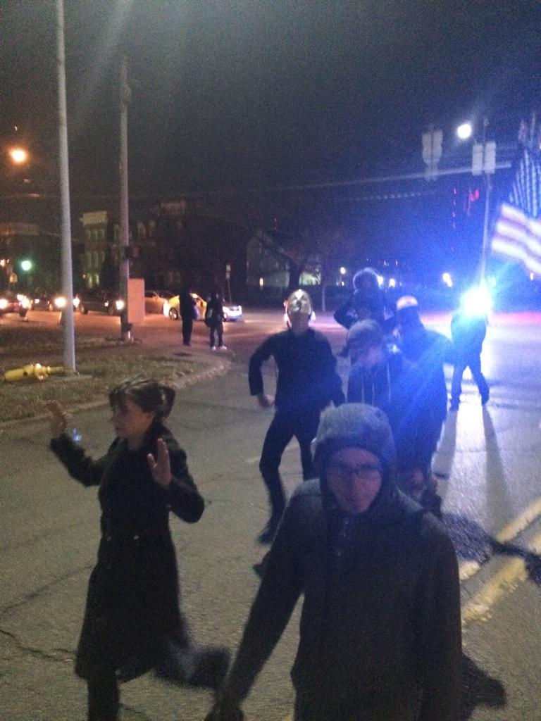 Good amount of police blocking off streets as crowd continues. Now on Ezzard Charles  http://t.co/uVSY3Vl8TI via @Fox19Brett
