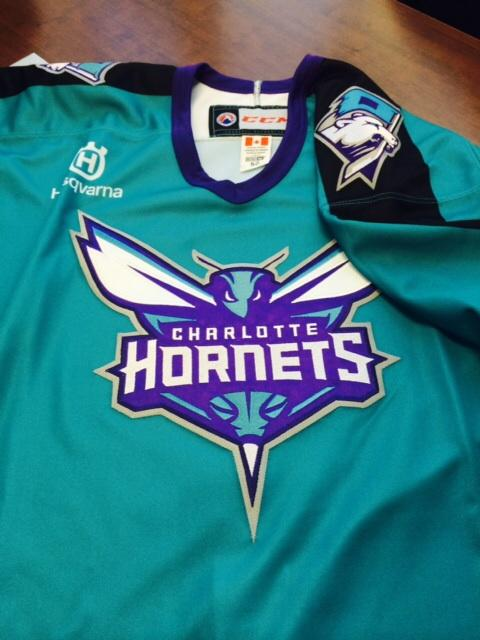new style 98a42 bc412 Charlotte Checkers hockey team wearing Hornets jerseys ...