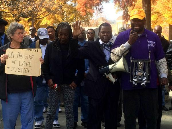 Protestors in Birmingham demand justice, call for non-violence in #Ferguson  http://t.co/p4ILLxrt85 http://t.co/K2rQsDYsau
