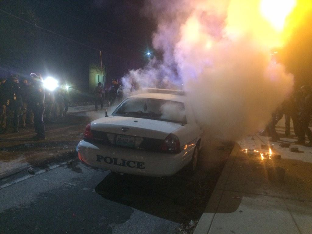 Protestors just lit a #Ferguson Police Car on fire. And Police just shot everyone w/ tear gas. Everyone running. http://t.co/OXwM3GK3lf