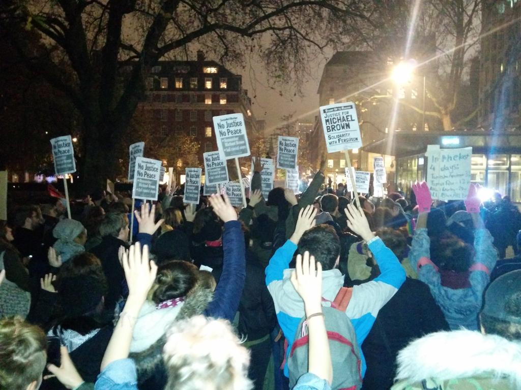 Hands up! Don't shoot! London outside of US Embassy right now. Justice for #MichaelBrown #LondonToFerguson #Ferguson http://t.co/Lv0yTHzCCW