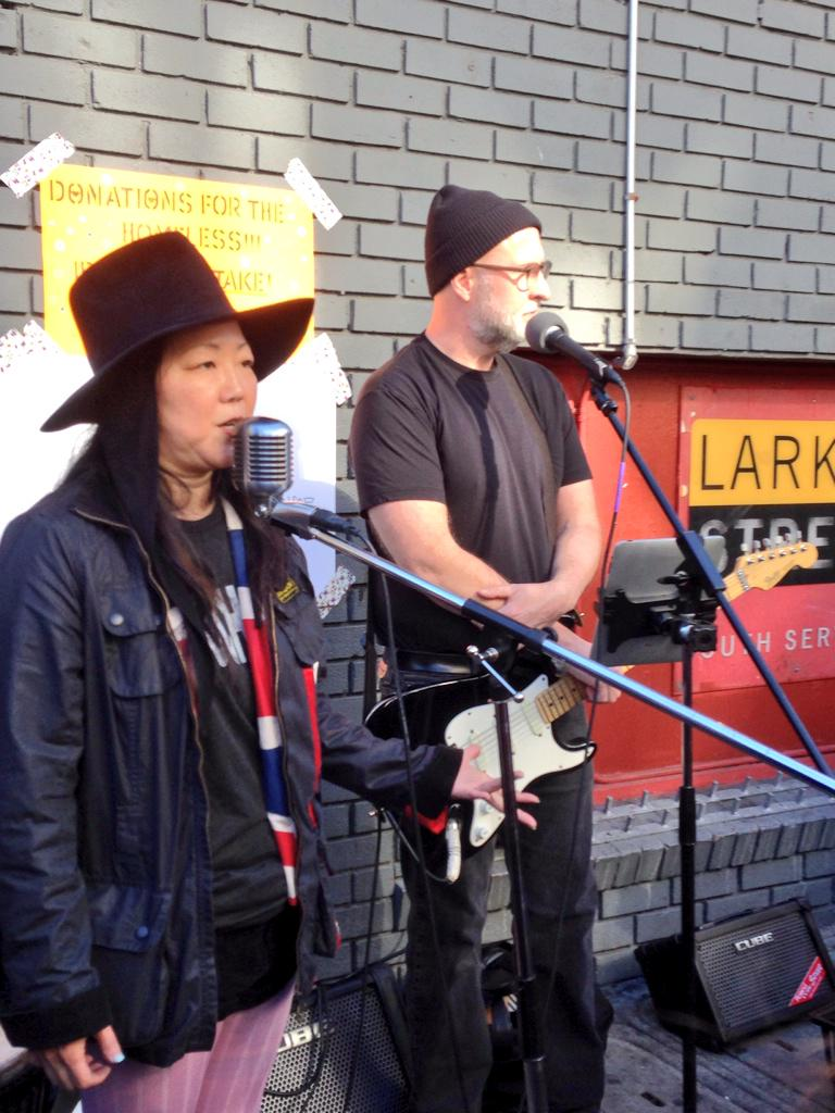 The great @bobmould & @margaretcho busking on Ellis Street to support @LarkinStreet. #BeRobin http://t.co/YE2BBkG7k9