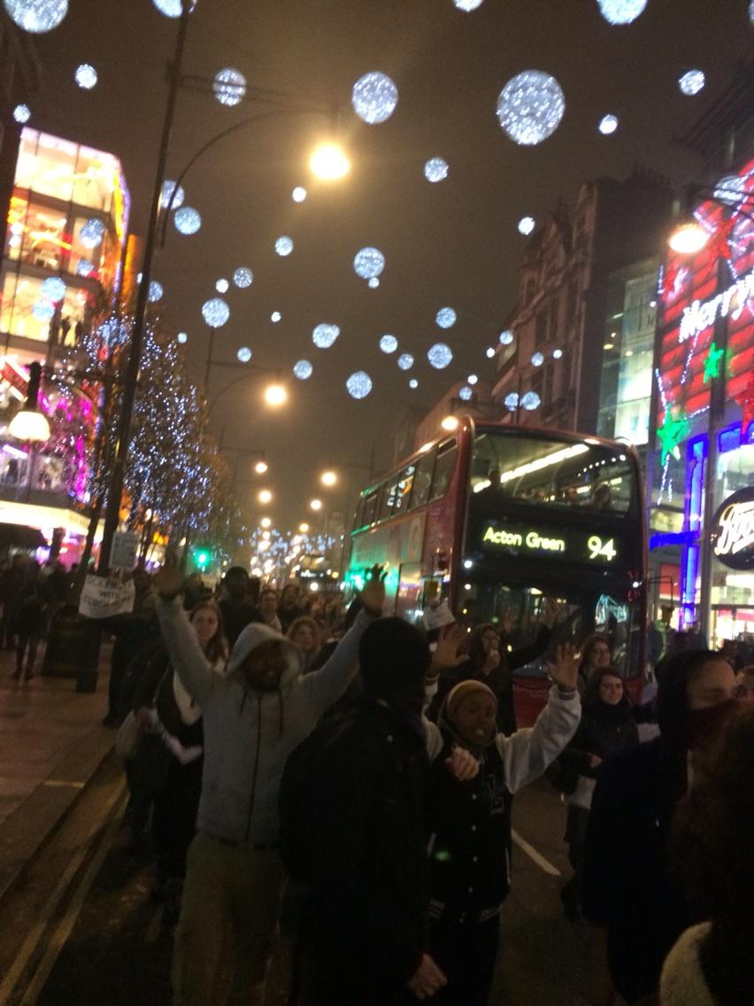 """""""Hands up, don't shoot"""" now taking over Oxford St #londontoferguson http://t.co/eL2oacNlDB"""