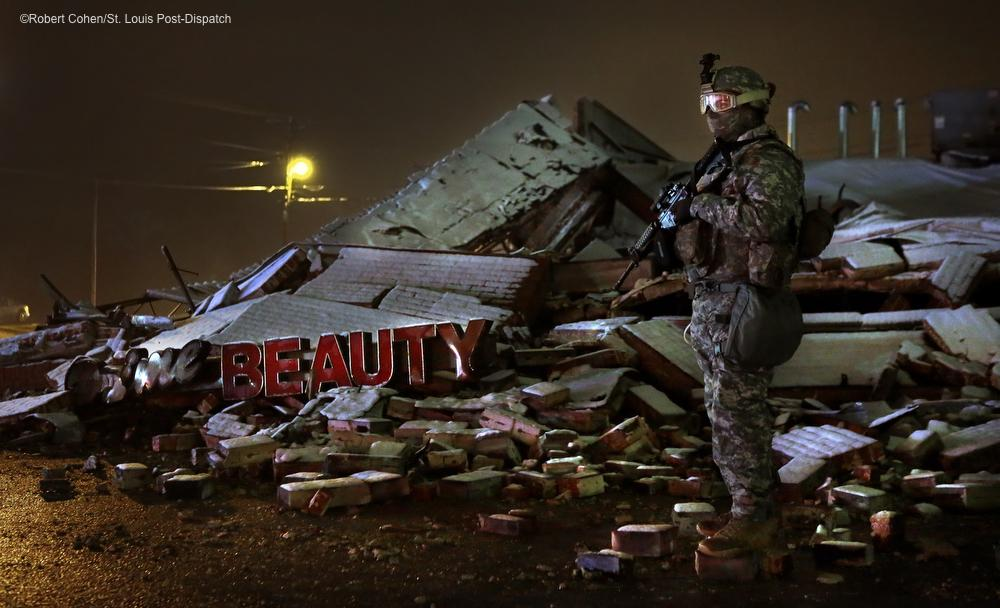 RT @kodacohen: National Guardsmen stand watch over the remains of Jade's Nails in #Ferguson. http://t.co/ho2YpqSma8
