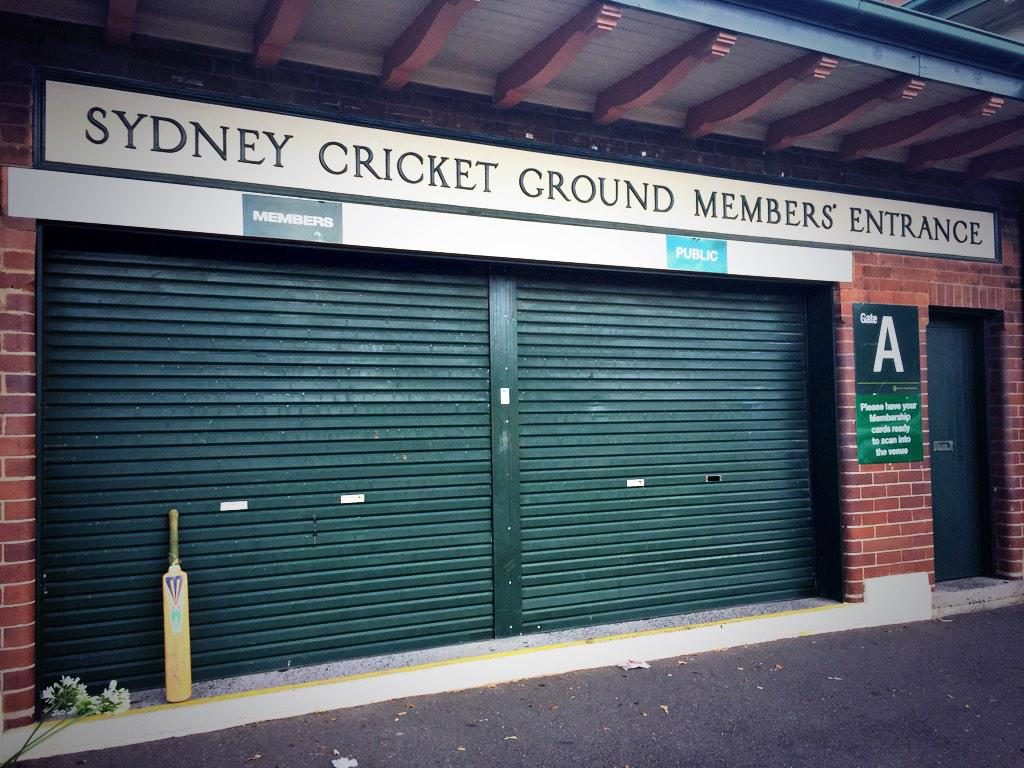 "A single cricket bat at the entrance to the SCG.  The writing on the bat says ""63no Forever"". #putoutyourbats http://t.co/KBh24oBfEn"