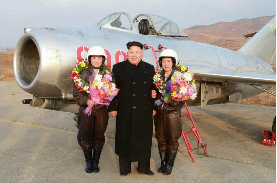 Kim Jong-un visits female fighter pilots.  Snap photos himself. http://t.co/pSraxlei11