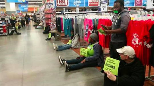 Wal-Mart workers are revolting today. What will you do? #buynothingday #WalmartStrikers http://t.co/E32b2V8NhJ http://t.co/58Jg3Q4ENd