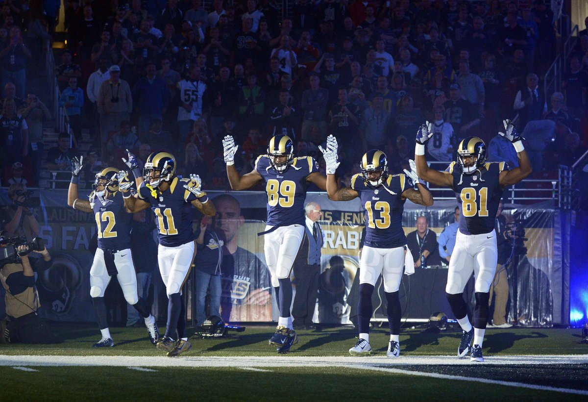 """Hands Up, Don't Shoot"" several @stlouisrams players enter field in response to #Ferguson: http://t.co/yDnOiRMGMb http://t.co/ztNDy98GIi"