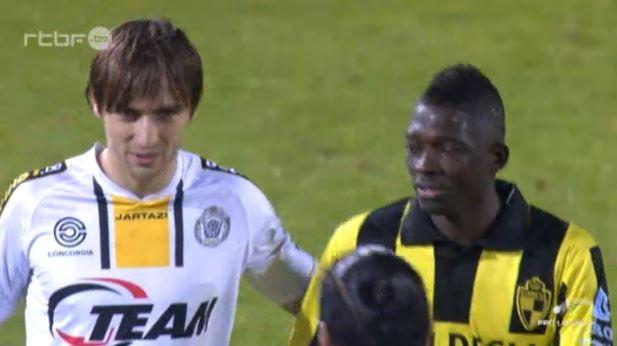 Abdurahimi chats with a Lierse player after the whistle