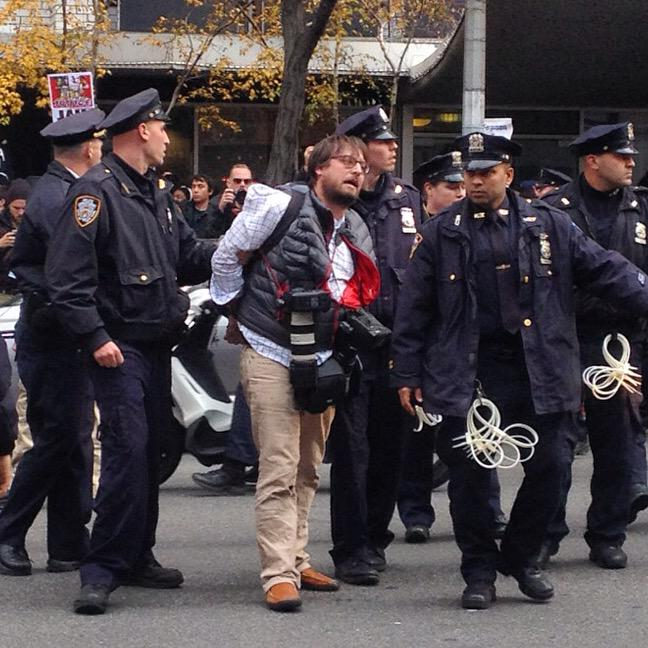 Journalist getting arrested by NYPD at #HandsUpWalkOut march in NYC. http://t.co/7zQkIDtOHM