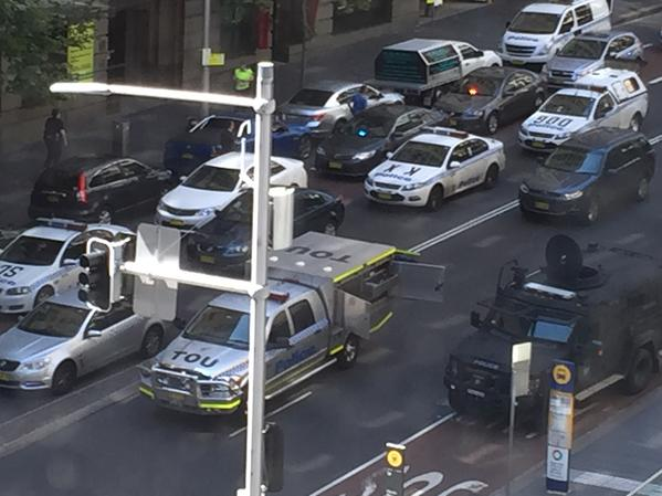 Large police presence at Martin Place as siege at Lindt Café continues. Photo: Chris Horne #9News http://t.co/zxydi1mCno