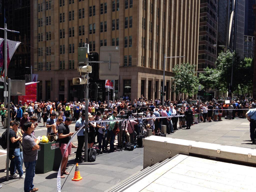 A crowd gathers near Martin Place. #sydneysiege http://t.co/7NdqPYhwcY @JezNews http://t.co/hCgUyOcuhn