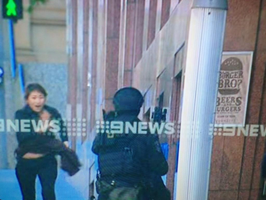 Two female hostages have managed to get out. This brings a total of five to have escaped. Chilling pics on @9NewsAUS. http://t.co/sVNHz3Y5Hj