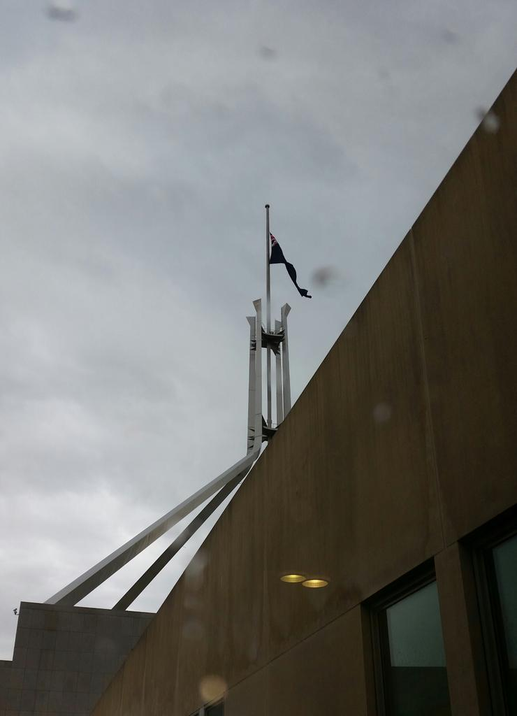 Parliament House flag has been lowered to half mast #MartinPlace http://t.co/0QPC0AAsmK