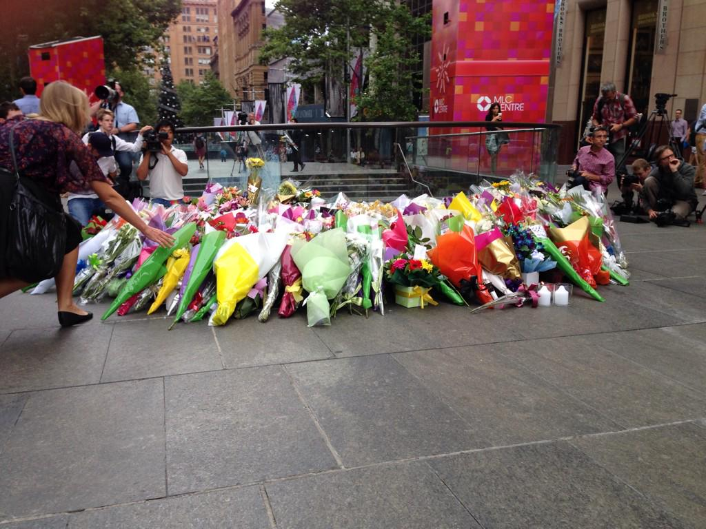 A collection of flowers continues to build in Martin Place at Castlereagh St @SBSNews http://t.co/RJ95dYM220