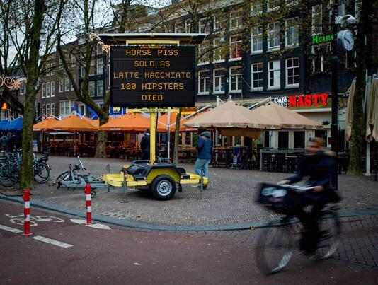 Too funny... Gheghe. Warning signs in Amsterdam hacked