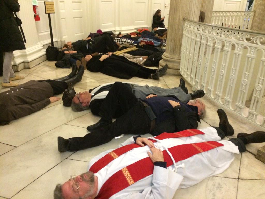 """@AnnaESanders: Clergy hold another die-in on the second floor of City Hall, the mayor's side. #EricGarner http://t.co/zFTjmHVhu5"""