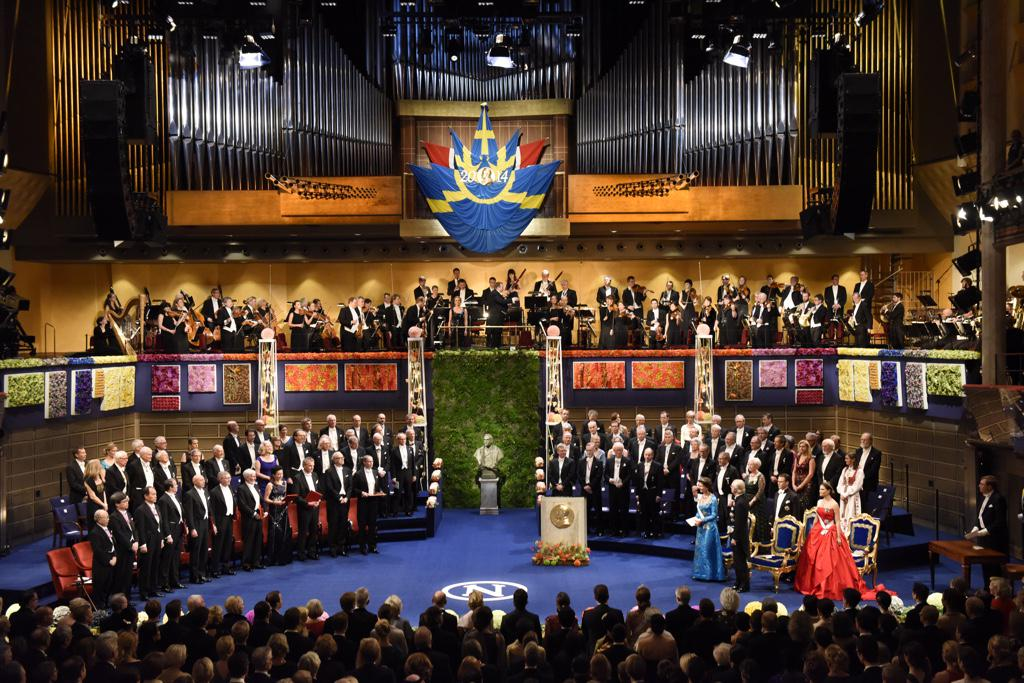 """The Nobel Prize on Twitter: """"All 2014 Nobel Laureates on stage, to the  left, at the #nobelprize2014 Award Ceremony in Stockholm.  http://t.co/PokqaLw0XA"""""""