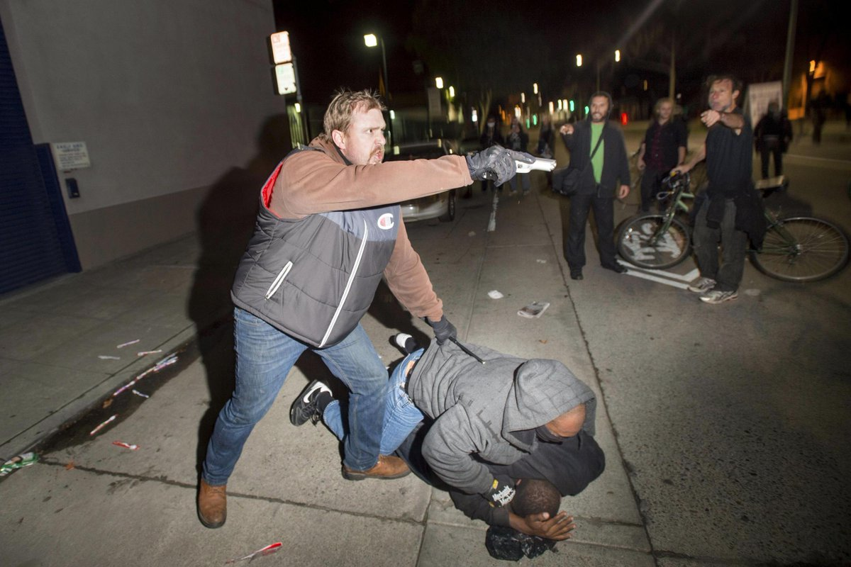 Cop draws gun on demonstrators in dramatic photos at overnight protest via @reuterspictures: http://t.co/EIjmB61afD http://t.co/shDr1uzgIU
