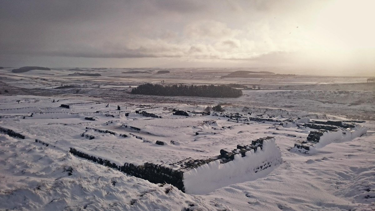 The first snow of winter has fallen over Hadrian's Wall. Imagine being a Roman soldier stationed here! #UKSnow http://t.co/BePk07MCet