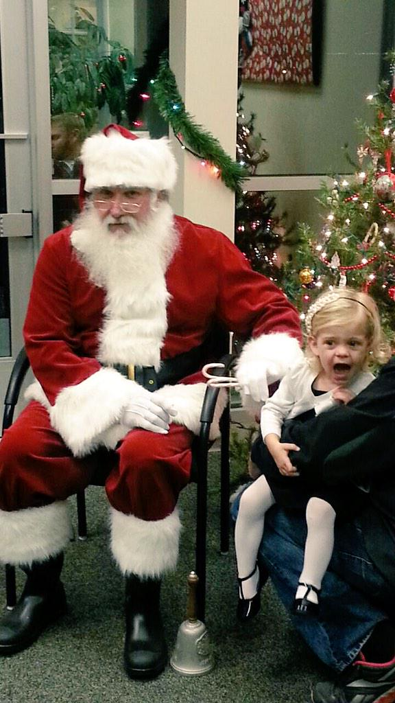 19 Hilarious Photos of Kids Who Really Don't Want to Sit on Santa's Lap