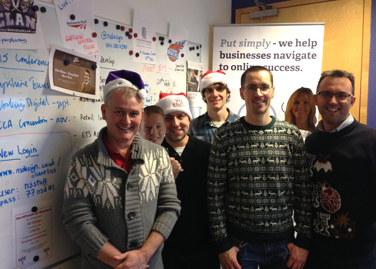 Enjoy our #ChristmasJumperDay team photo!  Jumpers, Santa hats, and faces stuck to coathangers!  Merry Christmas!! http://t.co/OLF367Izkr