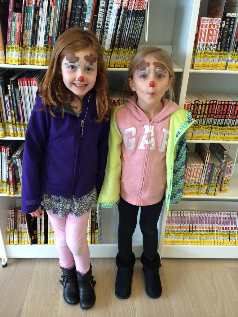 Cait and Mya enjoying the new library. #shelfie #ShareTheWow @hfxpublib http://t.co/XJ5USO8Khq