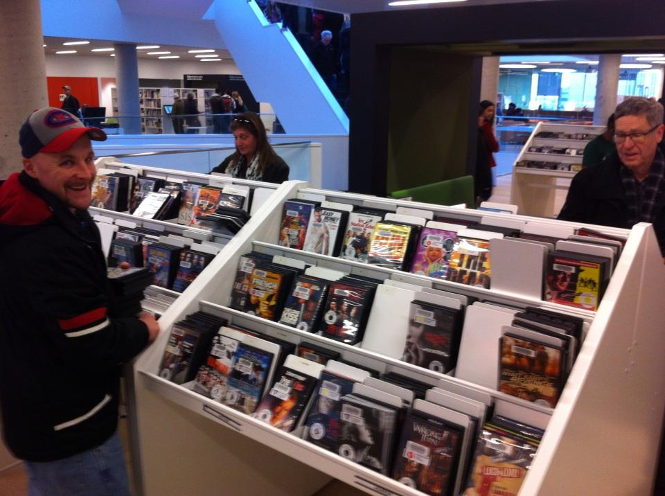 Customers browsing DVDs. Don't the stands remind you of music stores? Old with the new. #ShareTheWow http://t.co/XCCROUVodO