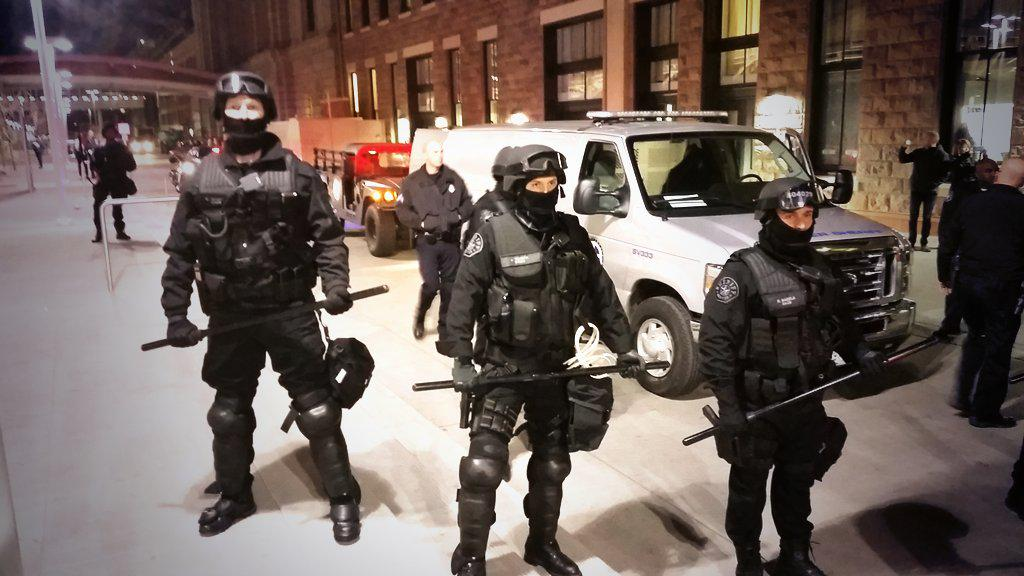 Cops in riot gear as protestors, over half of them students, March in #Denver for #solidarity with #MillionsMarchNYC http://t.co/3GFVZacs3R