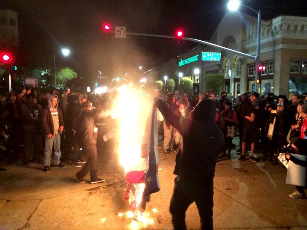 Leftists thugs burn American flag in Oakland