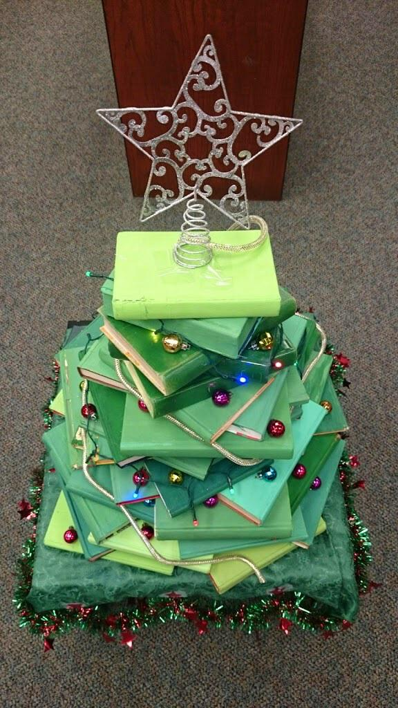 Ss painted discarded books green, and we created our Christmas tree. #txlchat READ mural made from bottle caps. http://t.co/a1HHd8csAk