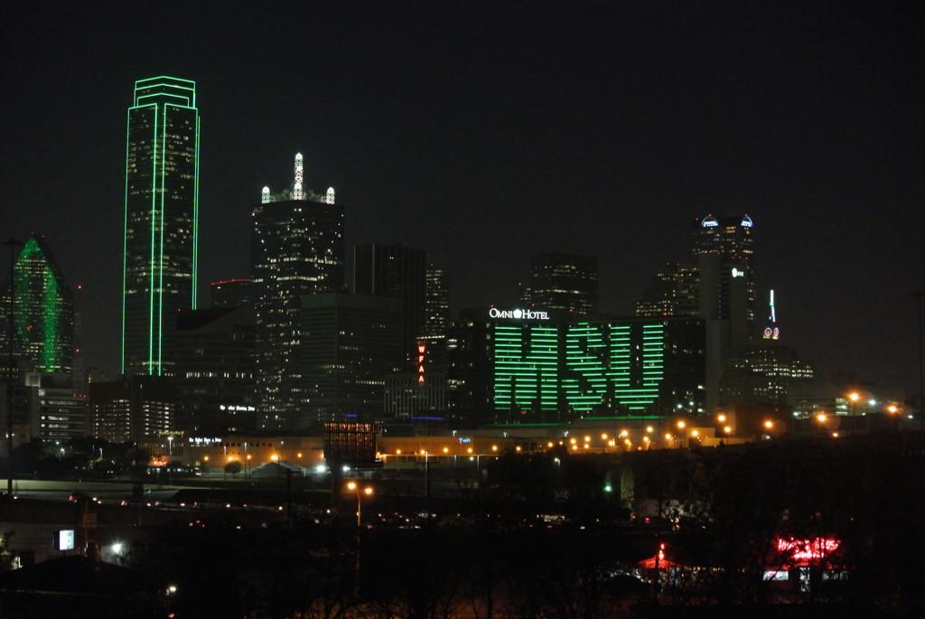 The Dallas @OmniHotels & surrounding buildings are Glowing Green in preparation for the @CottonBowlGame! #MSUCotton http://t.co/5mupBrbEXT