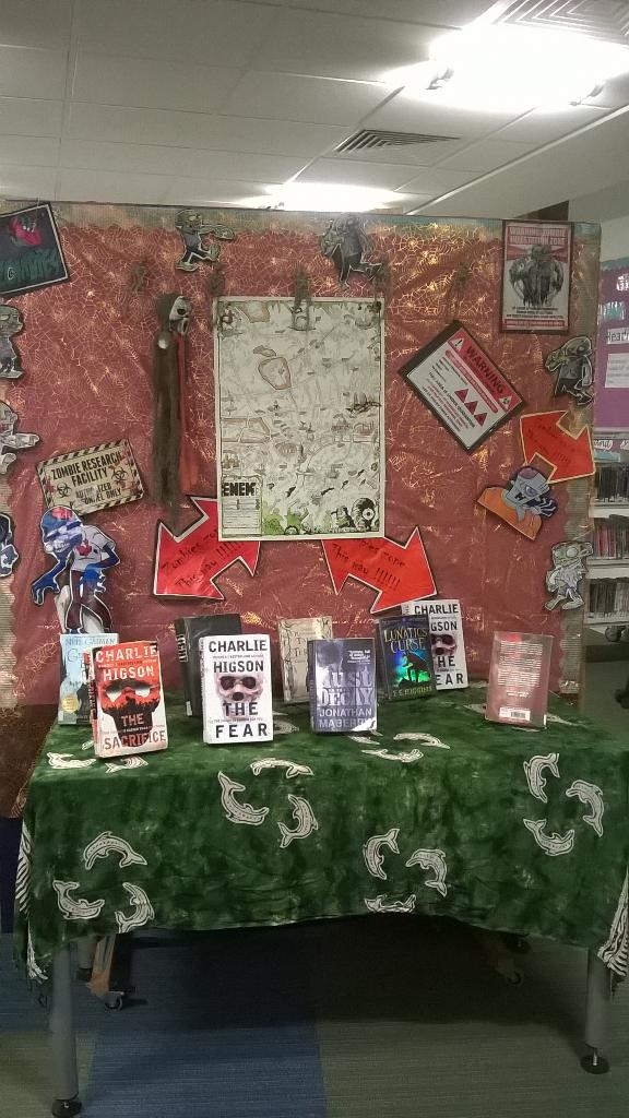 RT @jionalib: Zombie display, just in time for Xmas @WebbLibrarian replete with map from @monstroso 's Enemy series. http://t.co/U0JZH3kbTq