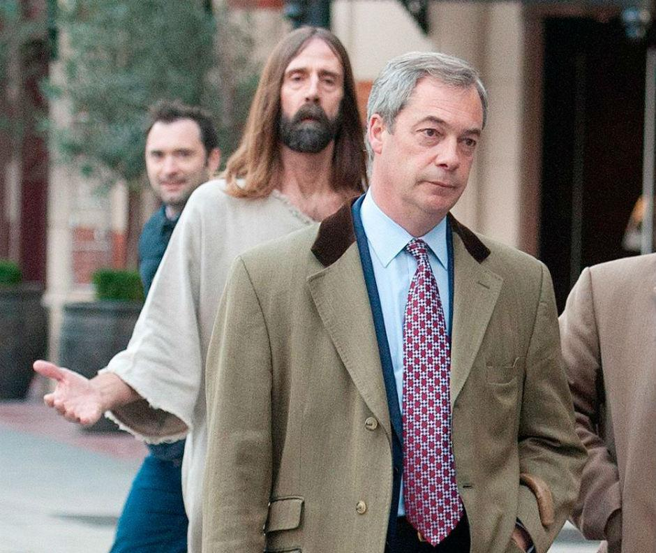 "today Nigel Farage is being followed around by a ""professional Jesus impersonator"" from LA http://t.co/JHCR71vagk http://t.co/9FMpGogL86"
