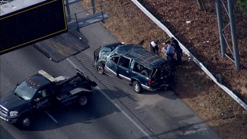 Police injuries reported crash south Lawrenceville Suwanee Road
