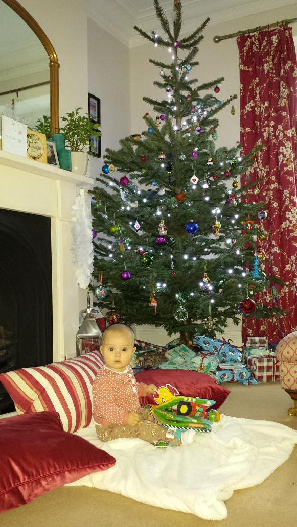 RT @emlawilko: Our first baby under her first Christmas tree! Merry Christmas @KirstieMAllsopp http://t.co/kNmPbScKpQ