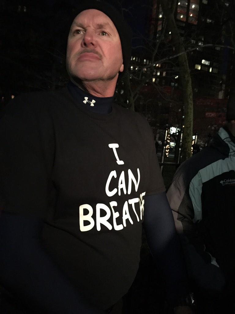 "Pro police demonstrators wearing ""I can breathe"" shirts at #BlueLivesMatter rally http://t.co/sBhYIHP9k4"