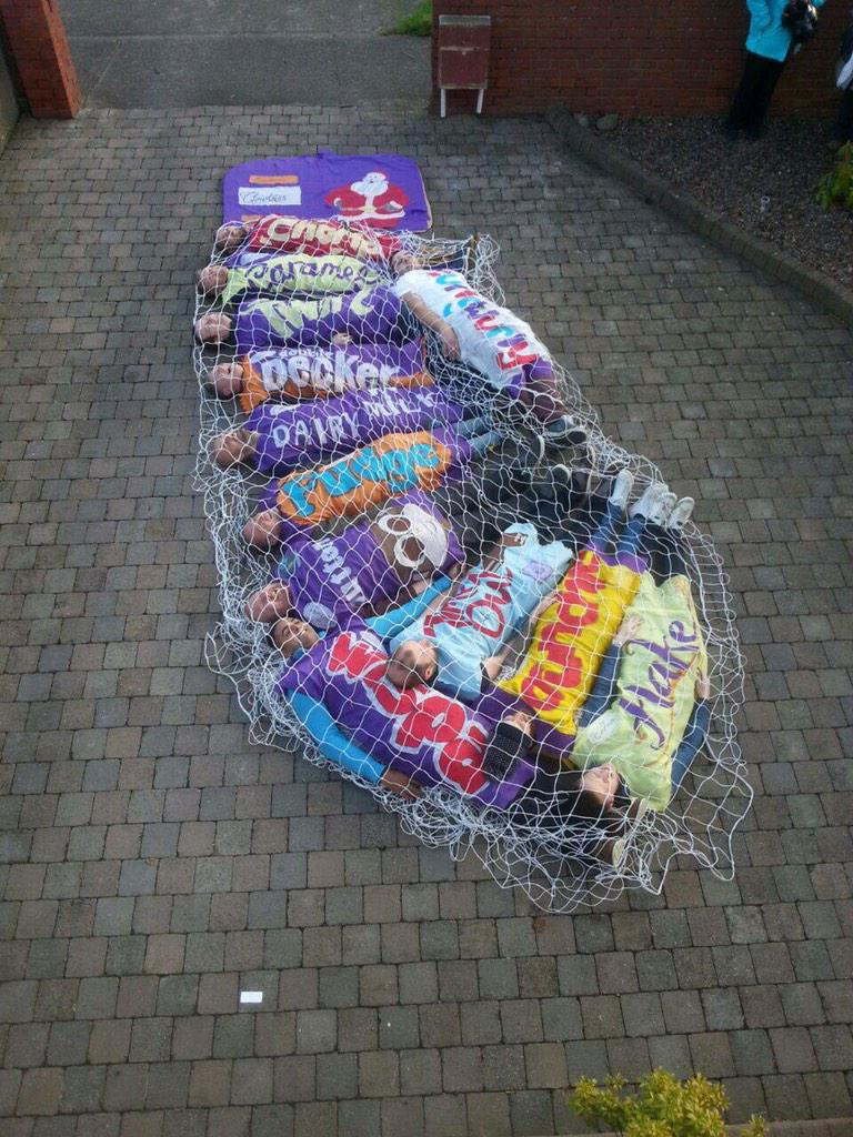 So there's a bunch of Irish lads doing the 12 pubs today dressed a selection box!! Absolute genius!!! http://t.co/Ez1I8GuZy4