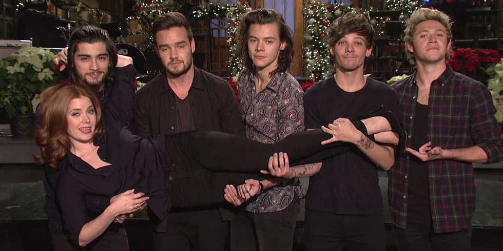 """STOP EVERYTHING and watch One Direction absolutely KILL IT on """"SNL"""": http://t.co/OluxhfKowQ http://t.co/BhYla1BE3Y"""